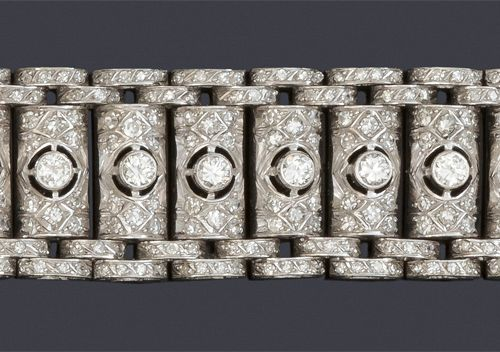 Articulated bracelet in platinum with geometrical decoration entirely paved with…