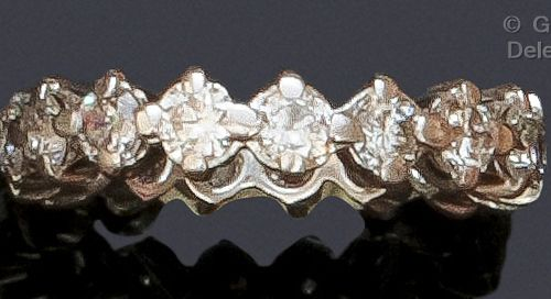 Wedding ring in white gold, entirely set with brilliant cut diamonds. Finger siz…