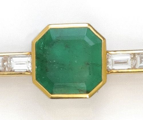 Yellow gold brooch with a square cut emerald set with baguette diamonds. Length …