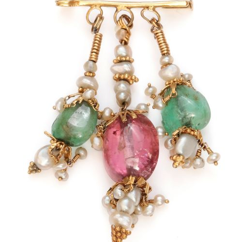 Gilded metal brooch, decorated with three pendants set with emeralds, tourmaline…