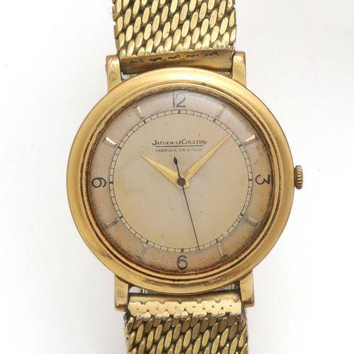 JAEGER LECOULTRE Bracelet montre en or jaune, boîtier rond, anses stylisées. Cad…