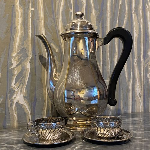 Tea and coffee set in silver plated metal composed of a teapot, a coffee pot, a …