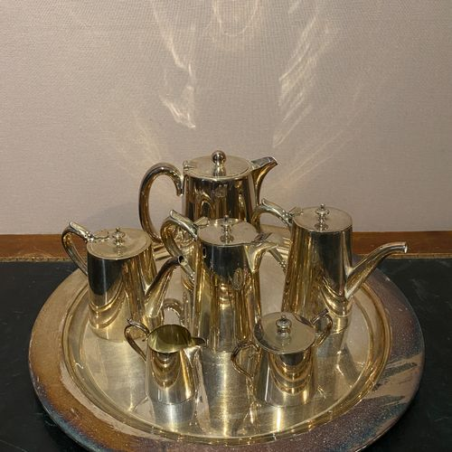 Tea and coffee set in silver metal composed of three pourers, a milk jug and a s…
