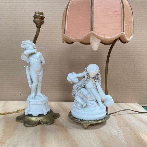 Pair of porcelain lamps featuring lovers playing with a garland of roses on a ci…