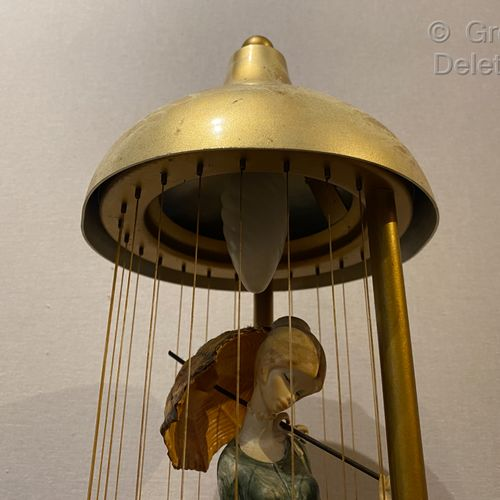 Lamp composed of two elements in gilded metal enclosing a network of nets formin…