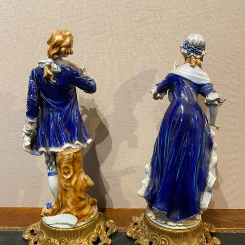 Italy, Tiche factory  Pair of partially blue enamelled porcelain statuettes repr…