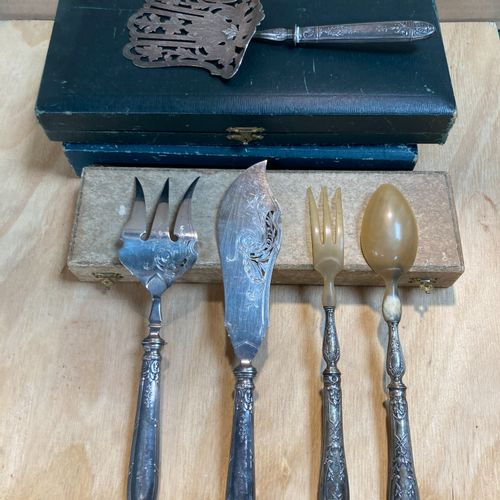 Set of silver cutlery with handles.  It consists of a silverware, a pie server, …