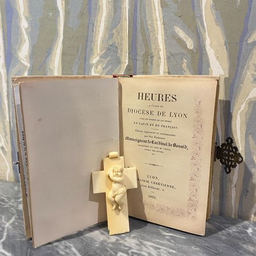 Hours for the use of the diocese of Lyon, 1862. Bound in ivory and silver. A bab…