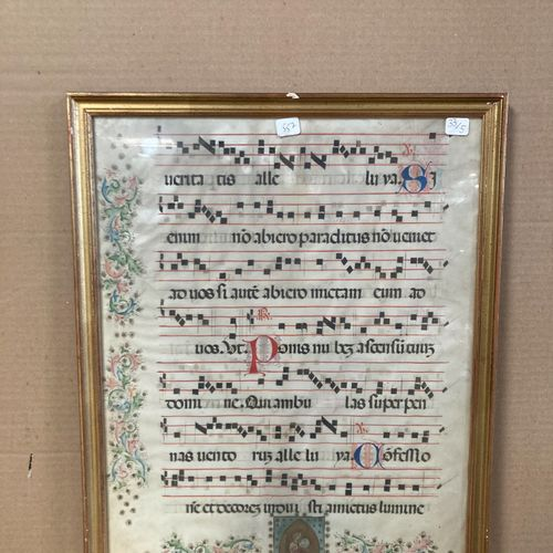 Antiphonal page on vellum with foliage and an angel with tambourine  50 x 37 cm