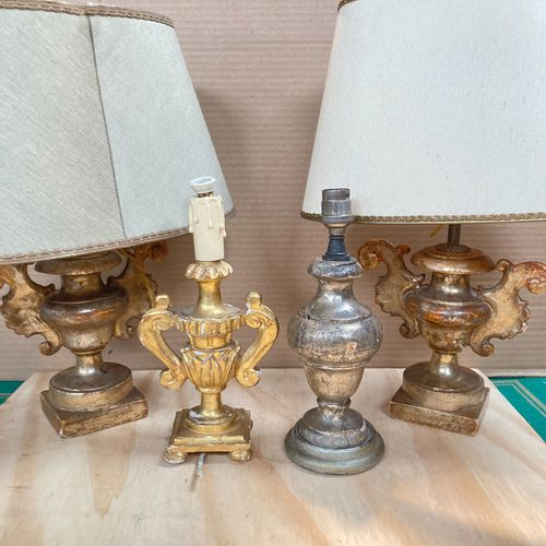 A pair of giltwood baluster lamps with two handles.  A silver plated wood balust…