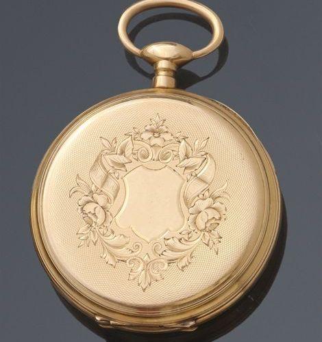 Montre de poche en or jaune, cadran émaillé blanc à chiffres romains. Poids brut…