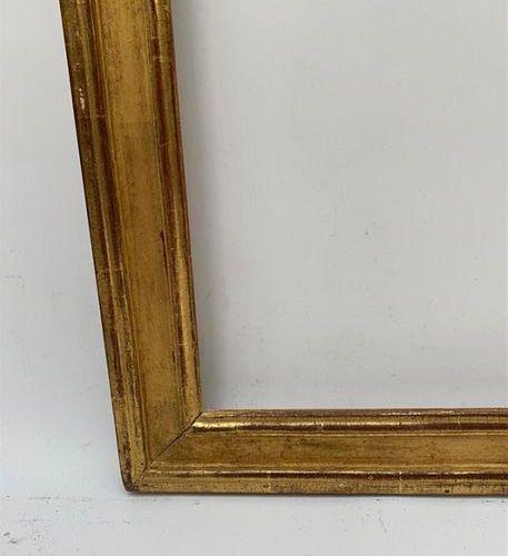 CADRE en bois mouluré et doré Epoque Louis XVI, porte une étiquette Infroid Pari…