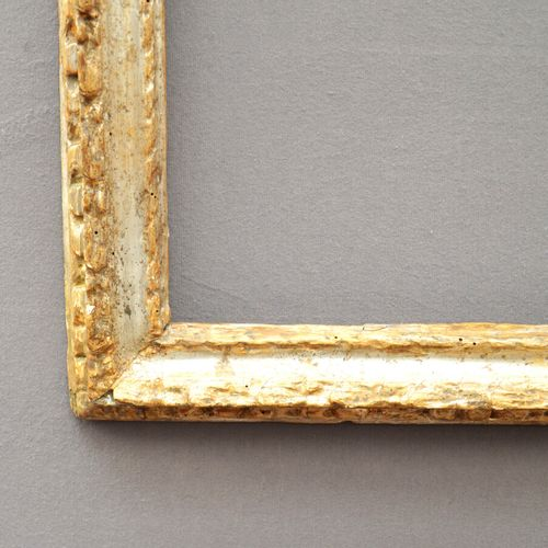 CADRE en bois mouluré sculpté et argenté à décor de tors de laurier  Italie, XVI…