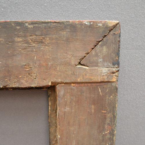 CADRE à profil renversé en bois mouluré noirci et anciennement doré à la mecca (…