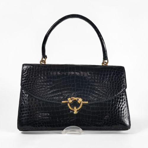 Hermès, Cordelière, sac à main  Croco noir, garniture tressée en métal doré, int…