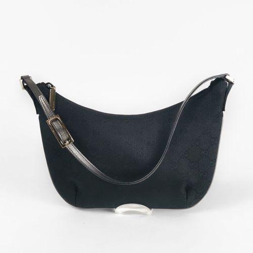 Gucci, pochette  Toile monogrammée noire et cuir argenté, fermeture Eclair, port…