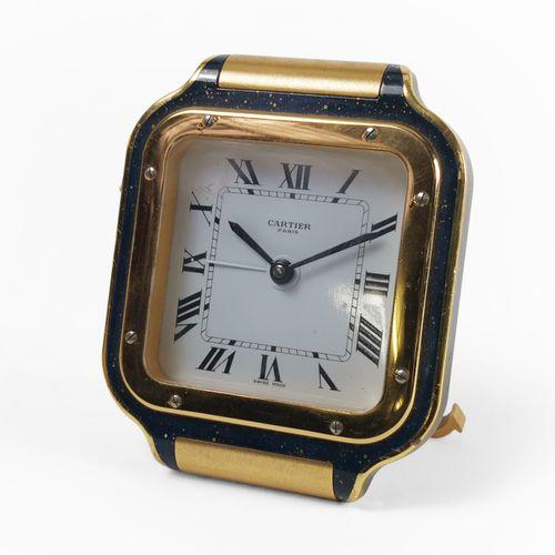 Cartier, Santos, pendulette réveil carrée  Imitation lapis lazulis, cadran blanc…