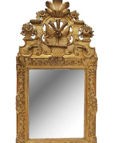 251 Rectangular gilded stucco carved wood mirror with stylized rinceaux decorati…