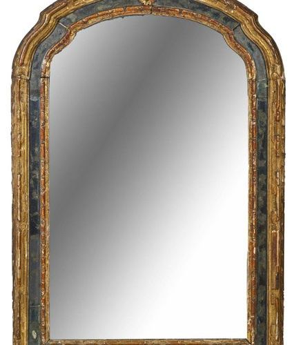 279 Moulded gilded wood mirror with gilded glazing beads, the pediment is animat…