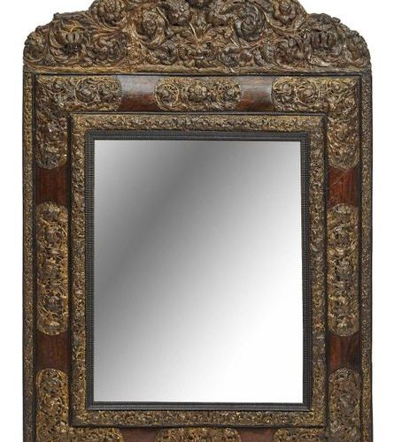 389 Important mirror in walnut and copper repoussé with flowers in bloom and scr…