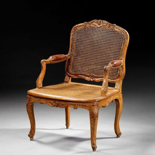 LOUIS PERIOD CANED OFFICE ARMCHAIR XV  Moulded and carved beech wood, with a mot…