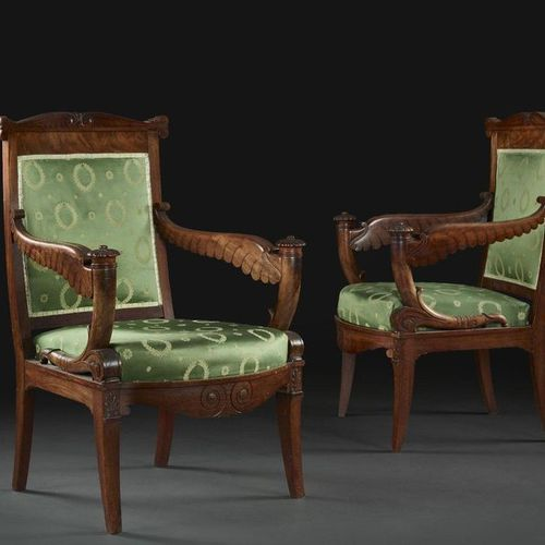 PAIR OF EMPIRE PERIOD ARMCHAIRS  In mahogany, the wing shaped armrest supports, …