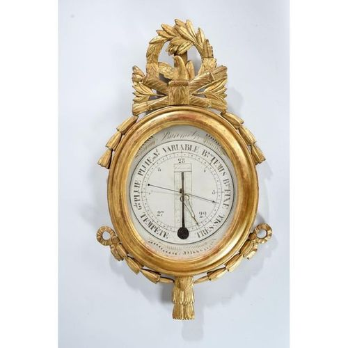 BAROMETER LOUIS XVI in gilded and carved wood with quiver decoration on which a …