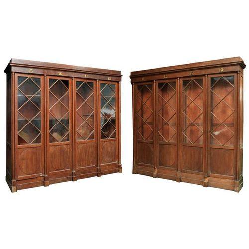 PAIRE DE BIBLIOTHEQUES EMPIRE en acajou et placage d'acajou ouvrant par 4 portes…