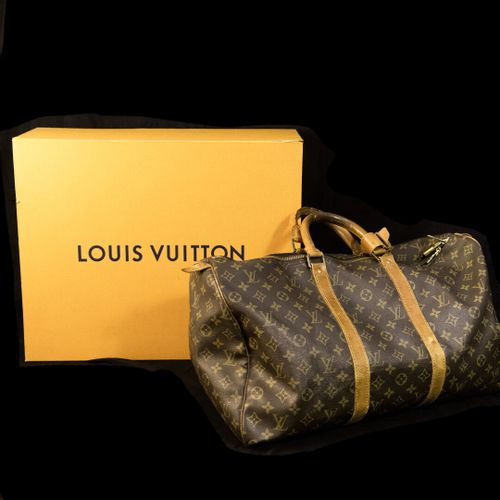 """Louis VUITTON """"Keepall 50"""" model  Bag in canvas coated with leather  With its pa…"""