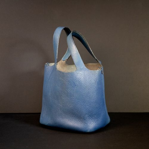 "HERMES Paris  Picotin"" bag in blue grained calf  H: 31 cm wear and tear and two …"