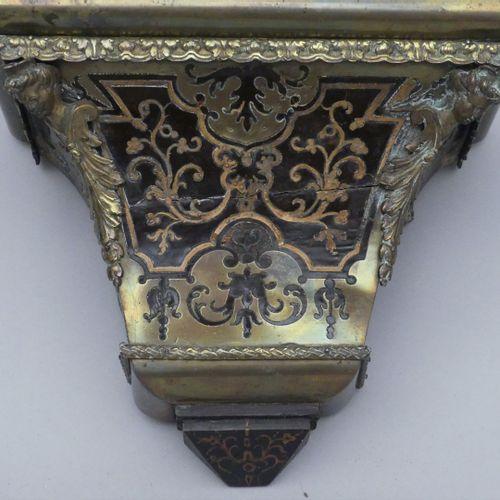 Cartel d'applique et son cul de lampe en marqueterie Boulle à riche décor de rin…
