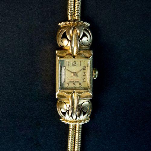 Montre de dame, boitier rectangulaire et bracelet en or, mouvement mécanique  Ve…
