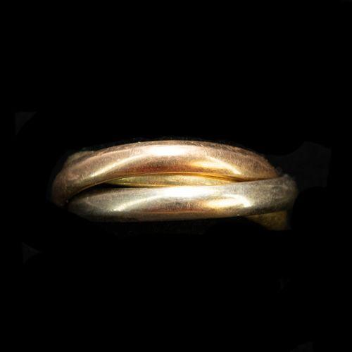 Alliance trinity dans le goût de Cartier trois or  Poids : 6.9 g Doigt: 50