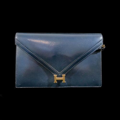 HERMES Paris , Lydie  Sac en box bleu marine et métal doré, fermeture pression, …