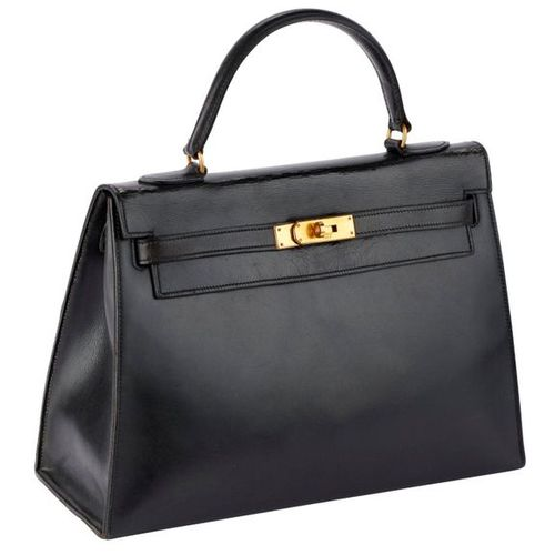 """Kelly bag """"32"""" in rigid black box, gold metal fasteners and clasp, handle, black…"""