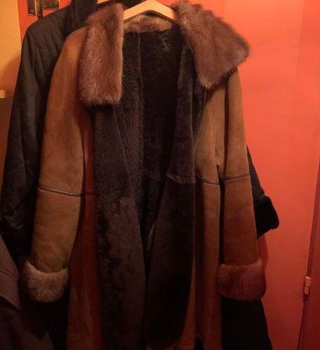 Manteau en cuir col fourrure en vison