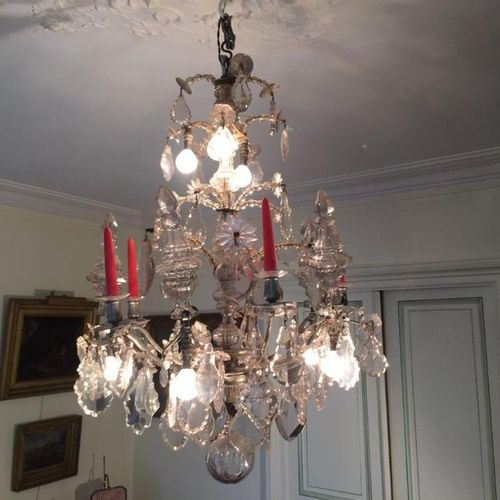Crystal chandelier with five light arms and five covered vases. 19th century. He…