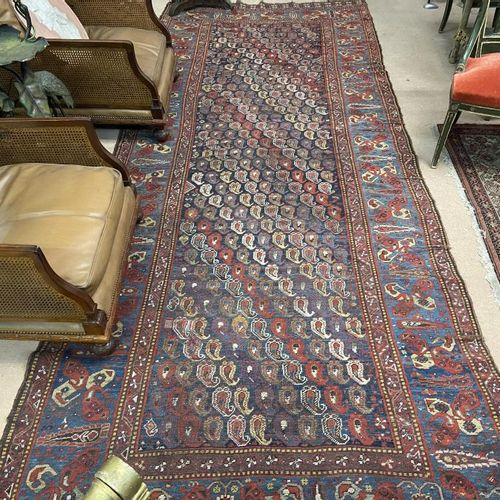Woollen rug. On a blue background with Boteh decoration. Border with light blue …