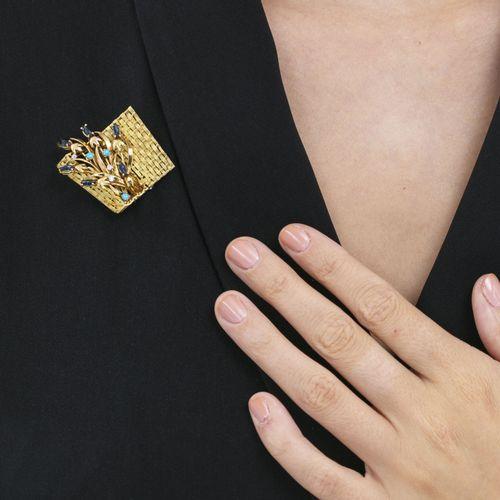 Broche panier de fleursor 750 sertie de turquoises taille cabochon, de diamants…