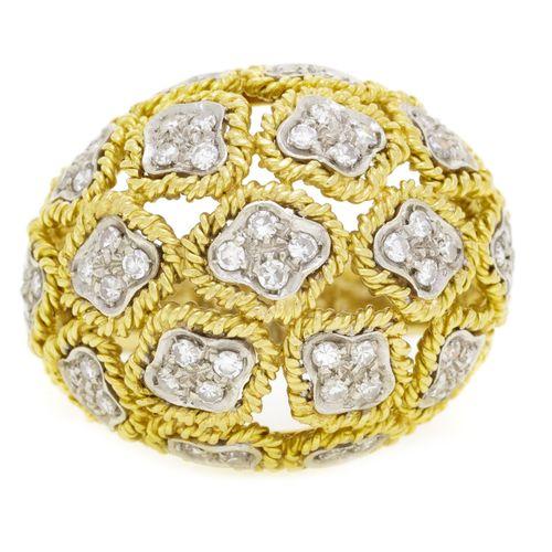 Bague composée de fils en or 750 torsadés s'enroulant autour d'éléments en or gr…