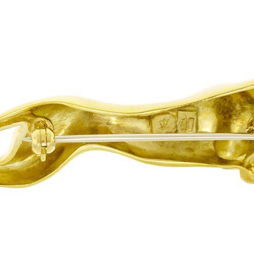 Broche panthère or 750, 'il serti d'un diamant taille brillant, long. 6.5 cm