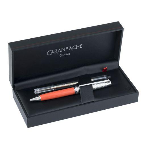 Caran d'Ache pour Patek Philippe, stylo bille en acier et résine orange, signé, …