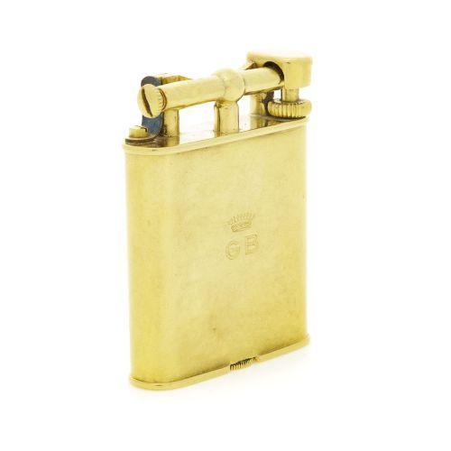 Dunhill, lot composé d'un briquet et d'un cure pipe or 750, 375 et métal, brique…
