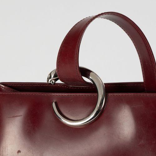 Cartier, sac à dos Must de Cartier en cuir lisse bordeaux, une bandoulière, 30x2…