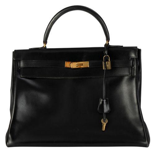 Hermès, sac Kelly 35 retourne en cuir Box noir, année 1972, bouclerie plaquée or…