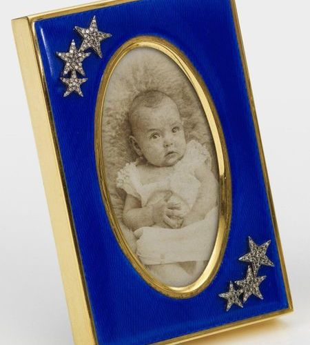 Small table picture frame in the style of Karl Fabergé. Silver, gold plated and …
