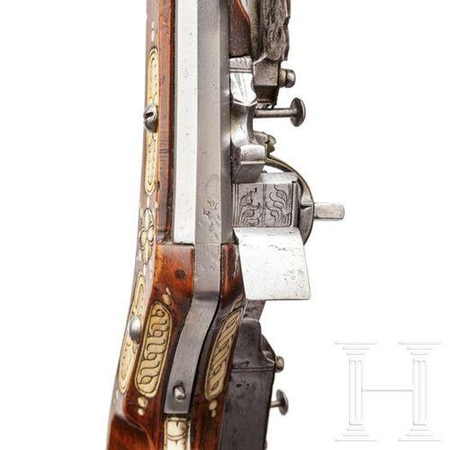 A Silesian wheel lock teschinke with brass adorned lock, circa 1650 Canon octogo…