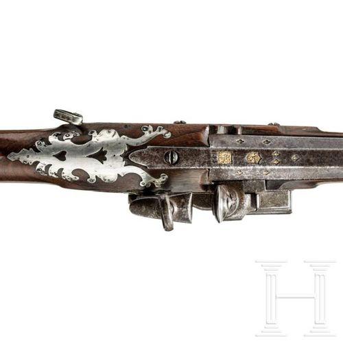 A Spanish silver mounted Miquelet flintlock shotgun, 18th century Canon octogona…