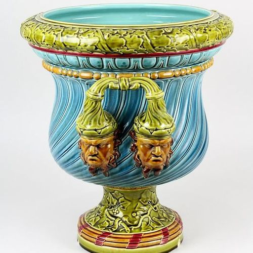 Saargemünd majolica cachepot with grotesque faces, in the shape of a crater vase…