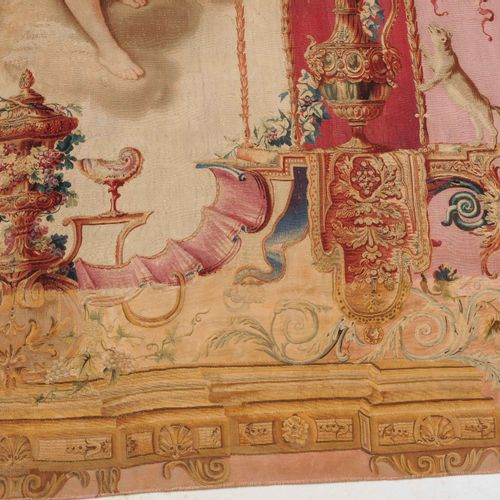 AUBUSSON 奥布森  法国,约1850年。 做工非常精细的挂毯。酒神和葡萄之神狄奥尼索斯与一位在云上的天使一起坐在一片明亮的田野上,头戴葡萄枝组成的头饰。…